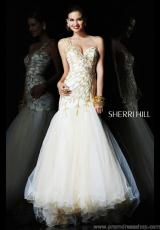 Sherri Hill 1572.  Available in Ivory/Gold