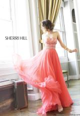 Sherri Hill 11088.  Available in Aqua/Gold, Black/Gold, Coral/Gold, Ivory/Gold, Royal/Gold