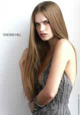 Sherri Hill 4811.  Available in Gunmetal