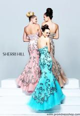 Sherri Hill 21058.  Available in Aqua, Black/Nude, Blush/Silver, Ivory/Gold, Nude, Red/Red